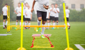 Boy Soccer Player In Training. Young Soccer Players at Practice Session